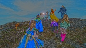 Children and Fairies ascend the hill.